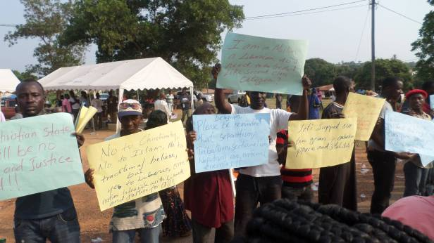 Muslim Youths holding placards with messages opposing any attempt to make Liberia a Christian state